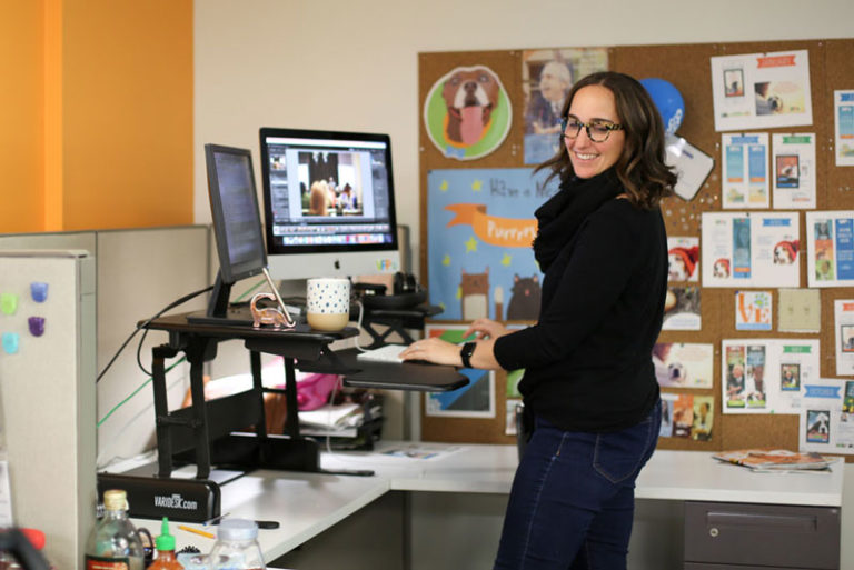 Brand Manager, Lindsay Kennedy, making good use of our standard-issue standing desks.